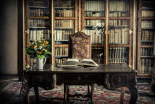 Old Library Office With A Book And A Buqet Of Flowers