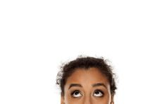 Half Portrait Of A Young Dark Skinned Girl Looking Up On White Background