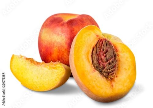 Fresh sweet peaches isolated on white background