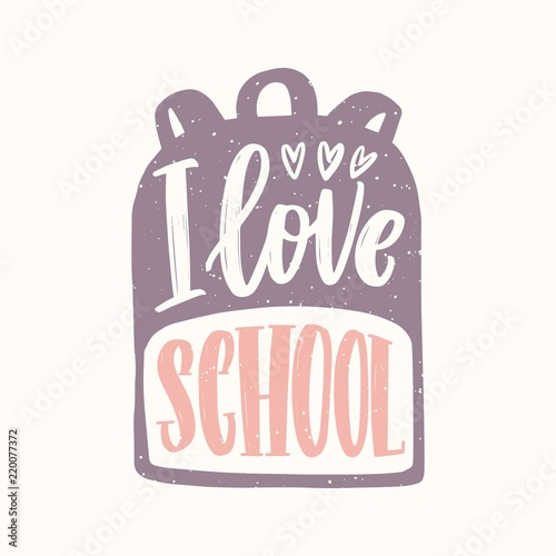 i love school message written with cursive calligraphic font on backpack decorative text handwritten with creative script isolated on white background