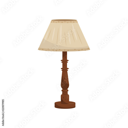 Fotografia Table or bedside lamp with beige fabric shade and wooden leg