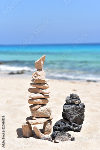Deurstickers Canarische Eilanden Stone tower on the Corralejo Beach in Fuerteventura Island, Canary Islands, Spain