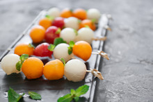 Plate With Tasty Melon Balls On Table, Closeup