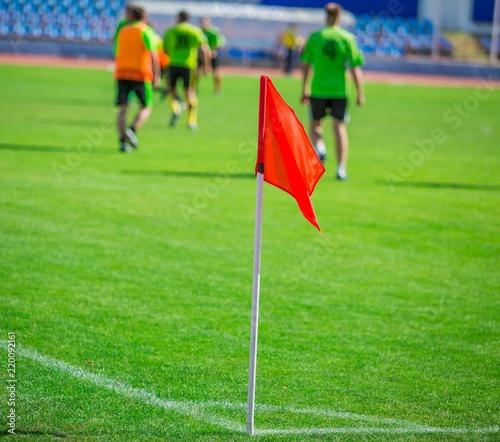 Obraz Football Corner Flag With Football Players In Background - fototapety do salonu