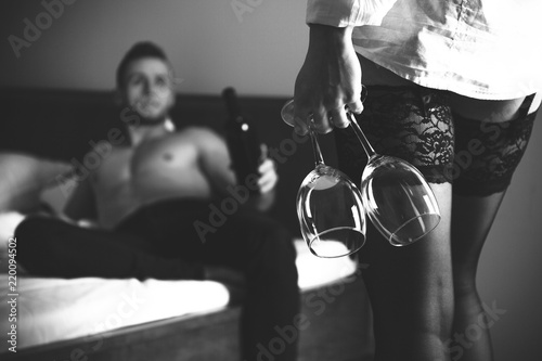 Woman With Glasses Of Wine During Erotic Foreplay With Man Black And White Photo