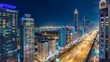 Scenic nighttime skyline of downtown Dubai, United Arab Emirates. Aerial view on highways and skyscrapers in the distance. 4K timelapse.