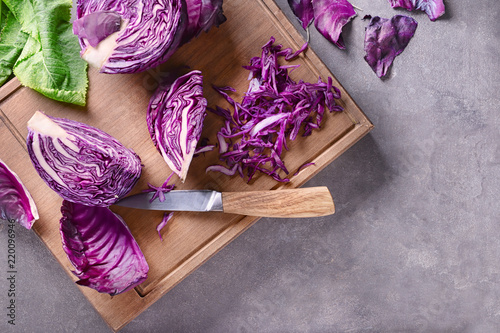 Photo Board with sliced red cabbage on grey table