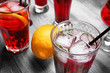 Glasses of fresh raspberry lemonade on wooden table, closeup