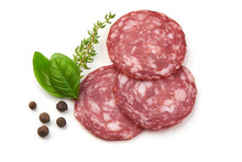 Sliced Salami Smoked Sausage, Basil Leaves And Peppercorns, Isolated On White Background.