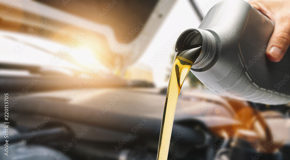 Fototapety, obrazy: Pouring oil to car engine