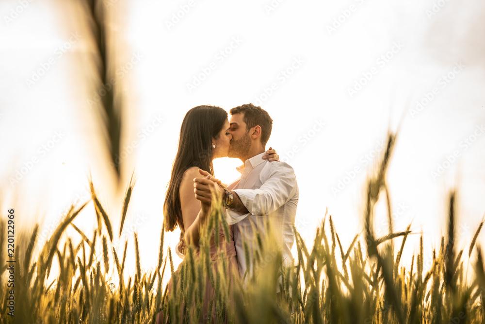 Fototapeta Romantic Couple Dancing on Love Moment at gold wheat field