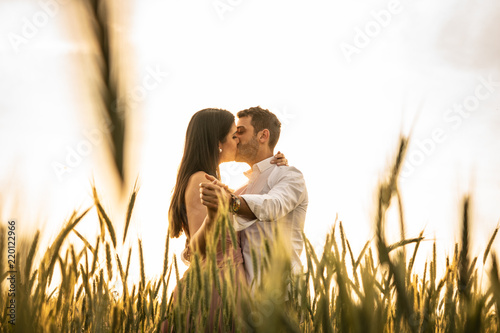 Fototapeta Romantic Couple Dancing on Love Moment at gold wheat field  obraz
