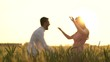 Romantic Couple Embracing at gold wheat flied