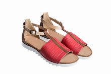 A Pair Of A Red And Brown Color Leather Ladies Sandals