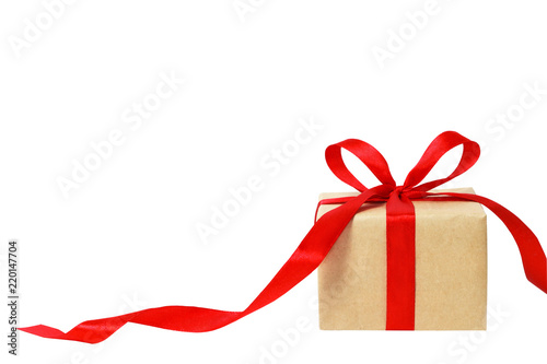 Fototapeta Gift box or present wrapped in craft paper. Holiday present. Festive background obraz