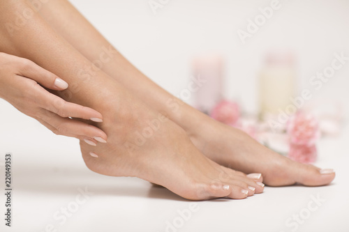 Poster Pedicure The picture of ideal done manicure and pedicure. Female hands and legs in the spa spot.