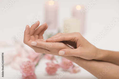 Skin care for hands. Closeup image of beautiful woman's hands with light pink manicure.