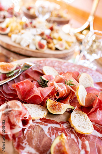 Foto op Canvas Buffet, Bar Food tray with delicious salami, pieces of sliced ham, sausage. Cutting sausage and cured meat on a celebratory table.
