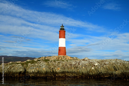 Foto op Aluminium Vuurtoren Vibrant red and white colored lighthouse against bright blue sky, Beagle channel, Ushuaia, Tierra del Fuego, Argentina