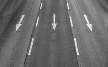 Three Arrows On A Three Lane Highway