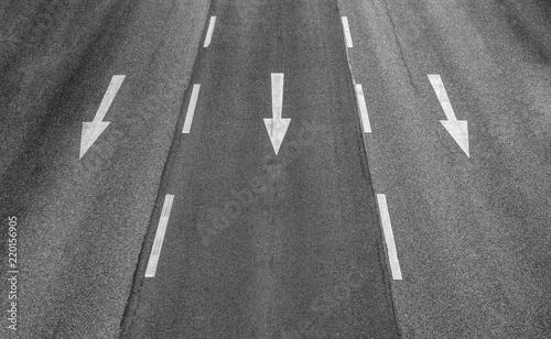 Photo Three arrows on a three lane highway