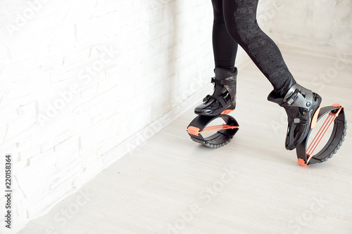 close-up in kangoo jumps boots indoors unrecognizable rear view Fototapeta