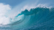 canvas print picture - CLOSE UP: Beautiful deep blue tube wave in the Pacific curls on a sunny day.