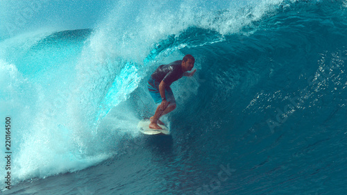 Fotografie, Obraz  CLOSE UP: Experienced male surfer gets almost swept by a large barrel wave