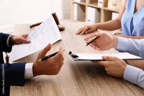 Lawyer working with clients at table in office, focus on hands Wallpaper Mural