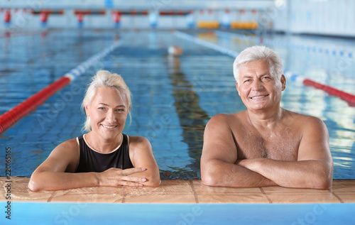 Sportive senior couple in indoor swimming pool