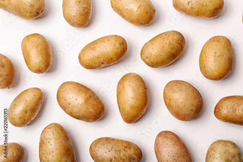 Flat lay composition with fresh organic potatoes on white background Fototapete