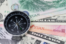 US And China Finance Economic Direction, Trade War, Import And Export Or World Economy Concept, Compass On US Dollar And China Yuan Banknotes, Tariff Deal Situation