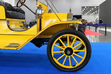 Fragment Of A Old Yellow Vintage Car On A Blue Background At The Exhibition