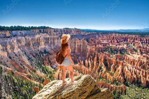 Girl standing on the top of the mountain looking at beautiful view. Inspiration Point. Bryce Canyon National Park,Utah, USA