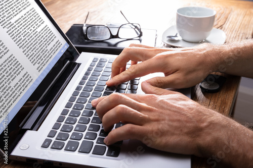 Canvastavla Close-up Of A Person Typing On Laptop