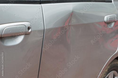 Fotografie, Obraz Door car with damage on accident with dent on left side