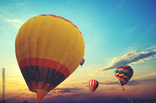 Colorful hot air balloon flying on sky at sunset. travel and air transportation concept - vintage and retro filter effect style. balloon carnival in Thailand