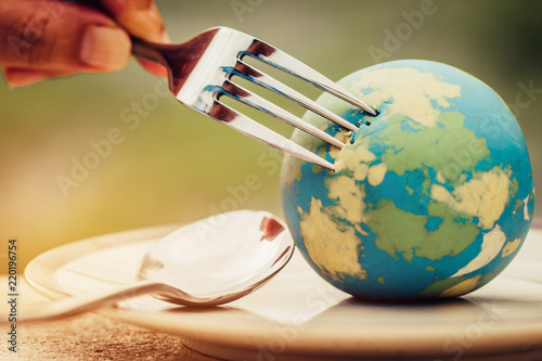 Fork slammed on Globe model placed on plate  for serve menu in famous hotel. International cuisine is practiced around the world often associated with specific region country. World food inter concept