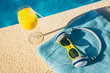 A glass of orange juice, headphones and sunglasses are indispensable attributes of recreation - the concept of tourism and vacations