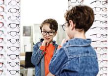 Boy  In Glasses At Optics Stor...
