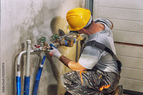 plumbing services, plumber at work Poster Mural XXL