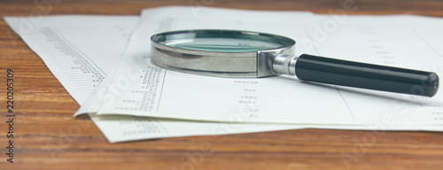 Canvas Print magnifying glass and document