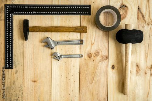 Fotografie, Obraz  Diferentes herramientas de trabajo y reparación sobre fondo de madera con hueco