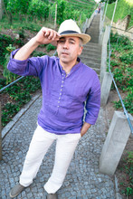 Funny Man In Hat Is Fooling Around Near Stone Stairs Outdoors