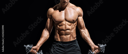 Fotografie, Tablou  Sporty man working out with dumbbells