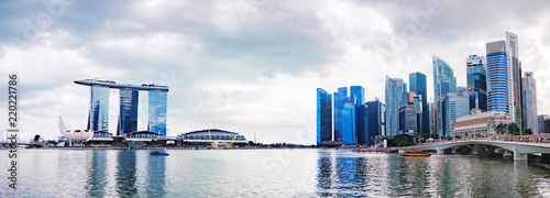 View of the downtown core of Singapore in Central Business District and the Singapore skyline seen above the waterfront of Marina Bay