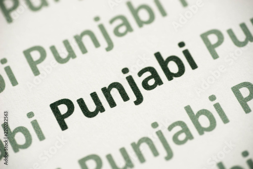 Valokuva  word Punjabi language printed on paper macro