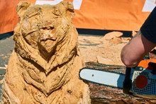 Experienced Carpenter Making A Big Wooden Bear Sculpture With A Chainsaw