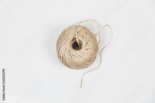 Leinwand Poster Roll of Twine Cord Isolated On White Background Top View
