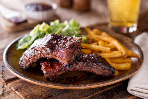 Foto op Plexiglas Grill / Barbecue Barbecue Ribs with Fries and Salad